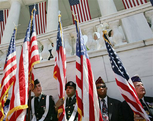 Flag bearers take their seats as they listen to President Bush speak at Arlington National Cemetery Memorial Day commemoration, Monday, May 29, 2006 in Arlington, Va. &#40;AP Photo&#47;Pablo Martinez Monsivais&#41; <span class=meta>(AP Photo&#47; PABLO MARTINEZ MONSIVAIS)</span>