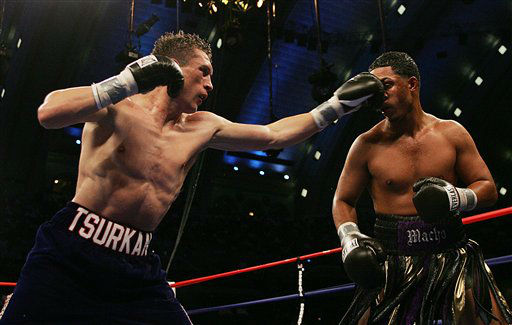 "<div class=""meta ""><span class=""caption-text "">Andrey Tsurkan, left, of Pelham Manor, N.Y., throws a punch into Hector Camacho Jr. of San Juan, Puerto Rico, during the eighth round at Boardwalk Hall in Atlantic City, N.J. on Saturday, June 10, 2006. Tsurkan won with a TKO. (AP Photo/Tim Larsen) (AP Photo/ TIM LARSEN)</span></div>"