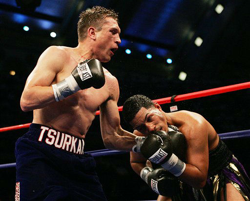 Andrey Tsurkan, left, of Pelham Manor, N.Y., throws an uppercut into Hector Camacho Jr. of San Juan, Puerto Rico, during the eighth round at Boardwalk Hall in Atlantic City, N.J. on Saturday, June 10, 2006. Tsurkan won with a TKO. &#40;AP Photo&#47;Tim Larsen&#41; <span class=meta>(AP Photo&#47; TIM LARSEN)</span>
