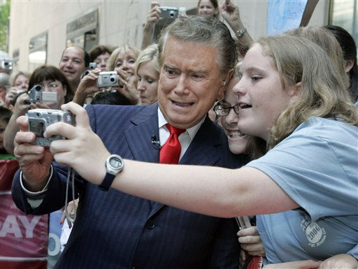 "<div class=""meta image-caption""><div class=""origin-logo origin-image ""><span></span></div><span class=""caption-text"">Regis Philbin, host of the NBC televison program ""America's Got Talent,"" takes a photo with Megan MacGregor, center, and Rebecca Murray, from Winston Salem, N.C., during his appearance on NBC""s ""Today"" show in New York's Rockefeller Center, Monday June 19, 2006. (AP Photo/Richard Drew) (AP Photo/ RICHARD DREW)</span></div>"