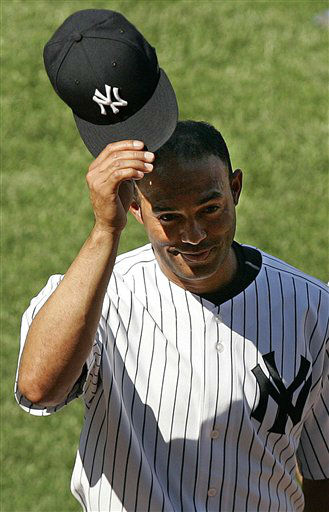 New York Yankees&#39; Mariano Rivera tips his hat to the crowd after recording his 400th career save in the Yankees 6-4 win against the Chicago White Sox in Major League Baseball action Sunday, July 16, 2006 at Yankee Stadium in New York.  &#40;AP Photo&#47;Julie Jacobson&#41; <span class=meta>(AP Photo&#47; JULIE JACOBSON)</span>