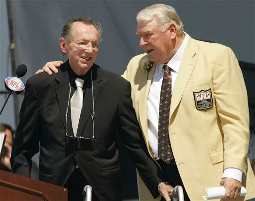 Former Oakland Raiders coach John Madden, right, puts his arm around Raiders owner Al Davis after Davis introduced Madden for enshrinement into the Pro Football Hall of Fame, Saturday, Aug. 5, 2006, in Canton, Ohio. &#40;AP Photo&#47;Mark Duncan&#41; <span class=meta>(AP Photo&#47; MARK DUNCAN)</span>