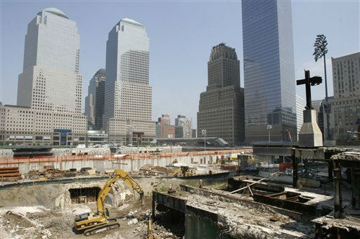 "<div class=""meta ""><span class=""caption-text "">**ONE OF SEVEN PHOTOS BY PETER MORGAN FOR USE AS DESIRED** Workers demolish old railroad tunnels, bottom, near a cross formed by beams from the original World Trade Center, at right, at the World Trade Center site in New York on August 1, 2006. September 11, 2006 is the fifth anniversary of the attacks on the trade center. (AP Photo/Peter Morgan) (AP Photo/ PETER MORGAN)</span></div>"