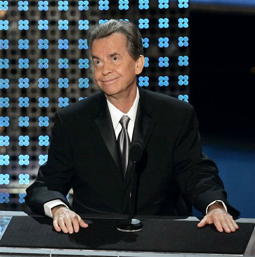 **FILE** Dick Clark speaks after receiving a special Emmy tribute at the  Primetime Emmy Awards on  Aug. 27, 2006, at the Shrine Auditorium in Los Angeles. Washington Redskins owner Daniel Snyder&#39;s RedZone Capital investment company on Tuesday, June 19, 2007, bought TV production company Dick Clark Productions Inc. for &#36;175 million in a deal that brings the Redskins and the &#34;Bloopers&#34; television show into the same corporate family. &#40;AP Photo&#47;Chris Carlson&#41; <span class=meta>(AP Photo&#47; CHRIS CARLSON)</span>