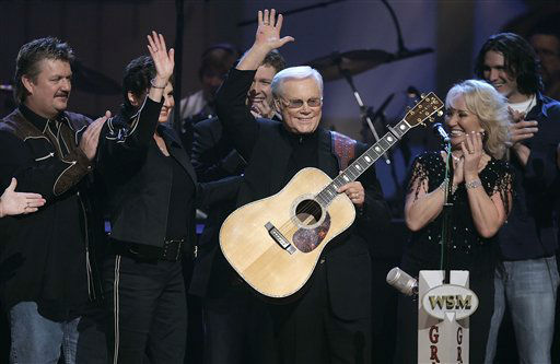 Country music legend George Jones waves to the crowd during his 75th birthday celebration at the Grand Ole Opry House in Nashville, Tenn., on Tuesday, Sept. 12, 2006. From left are Joe Diffie; Jones&#39; wife, Nancy; Craig Morgan; Jones; Tanya Tucker; and Joe Nichols. &#40;AP Photo&#47;Mark Humphrey&#41; <span class=meta>(AP Photo&#47; MARK HUMPHREY)</span>