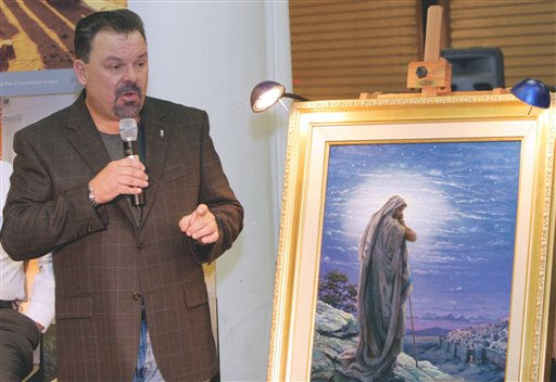 "<div class=""meta ""><span class=""caption-text "">Artist Thomas Kinkade unveils his painting, ""Prayer For Peace,"" at the opening of the exhibit ""From Abraham to Jesus,"" Friday, Sept. 15, 2006,  Kinkade, 54, died at his home in Los Gatos in the San Francisco Bay Area on Friday, April 6, 2012, of what appeared to be natural causes, David Satterfield said. (AP Photo/Gene Blythe) (AP Photo/ GENE BLYTHE)</span></div>"
