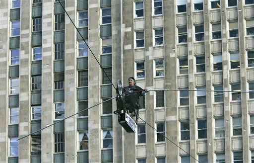 Mario Wallenda, of the famed Flying Wallendas, rides his specially constructed &#34;skycycle&#34; across the Chicago River Tuesday, Sept. 19, 2006, during a promotional event in downtown Chicago. Wallenda has been in a wheelchair since a high-wire accident in 1962 left him paralyzed from the waist down. The 60-something Wallenda said he was a bit afraid as the wire swayed in the wind. &#40;AP Photo&#47;Charles Rex Arbogast&#41; <span class=meta>(AP Photo&#47; CHARLES REX ARBOGAST)</span>