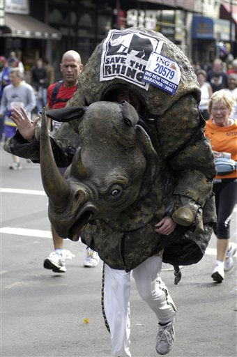 "<div class=""meta ""><span class=""caption-text "">A runner wearing a rhino costume in support of the organization savetherhino.org makes his way up Manhattan Avenue in the Greenpoint neighborhood of the Brooklyn borough of New York during the New York City Marathon, Sunday, Nov. 5, 2006.   (AP Photo/Benny Snyder) (AP Photo/ BENNY SNYDER)</span></div>"