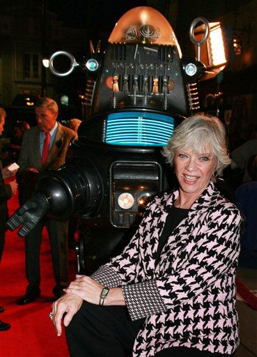 FILE-This Nov.8,2006, file photo supplied by Warner Home Video shows actress Anne Francis posing with Robby the Robot at a  screening to commemorate the 50th anniversary  of the film, &#34;Forbidden Planet,&#34; in Los Angeles. Francis, who was the love interest in the 1950s science-fiction classic &#34;Forbidden Planet&#34; and later was sexy private eye Honey West&#34; on TV, died on January 3, 2011. She was 80. &#40;AP Photo&#47;Warner Home Video,Alan Berliner,File &#41; <span class=meta>(AP Photo&#47; ALAN BERLINER)</span>