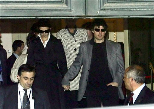 Superstars Tom Cruise and Katie Holmes leave a luxury hotel in Rome, Thursday, Nov. 16, 2006.  Cruise and Holmes are expected to marry at the weekend, in the lakeside town of Bracciano, just 60 kilometers &#40;37.5 miles&#41; from Rome. Media speculation about the wedding venue has focused on a 15th-century castle overlooking Lake Bracciano. &#40;AP Photo&#41; <span class=meta>(AP Photo&#47; Anonymous)</span>