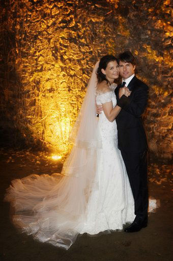 "<div class=""meta image-caption""><div class=""origin-logo origin-image ""><span></span></div><span class=""caption-text"">In this photo released by Rogers and Cowan, actor Tom Cruise and actress Katie Holmes pose in their wedding attire on Saturday, Nov. 18, 2006, at the 15th-century Odescalchi Castle overlooking Lake Bracciano outside of Rome.  (AP Photo/Robert Evans) (AP Photo/ ROBERT EVANS)</span></div>"