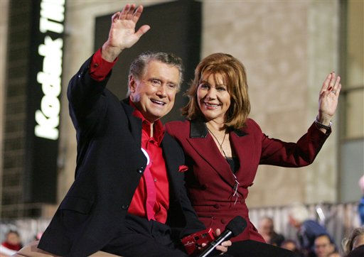 "<div class=""meta image-caption""><div class=""origin-logo origin-image ""><span></span></div><span class=""caption-text"">Regis and Joy Philbin wave to the crowd during the Hollywood Christmas Parade, Sunday, Nov. 26, 2006, in the Hollywood section of Los Angeles. (AP Photo/Jeff Lewis) (AP Photo/ JEFF LEWIS)</span></div>"