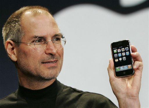"<div class=""meta image-caption""><div class=""origin-logo origin-image ""><span></span></div><span class=""caption-text"">**FILE** Apple CEO Steve Jobs demonstrates the new iPhone during his keynote address at MacWorld Conference & Expo in San Francisco in this Jan. 9, 2007 file photo. Cisco Systems Inc. and Apple Inc. said Wednesday, Feb. 21, 2007 they have settled the trademark-infringement lawsuit that threatened to derail Apple's use of the ""iPhone"" name for its much-hyped new iPod-cellular phone gadget.(AP Photo/Paul Sakuma, file) (AP Photo/ PAUL SAKUMA)</span></div>"