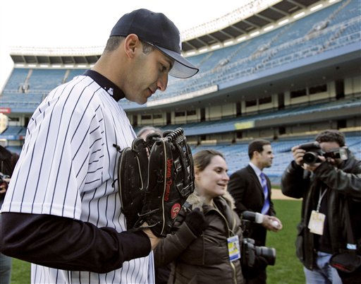 New York Yankees left-handed pitcher Andy Pettitte, leaves the mound followed by photographers after a photo session following his return to the team he pitched for from 1995-2003 at Yankee Stadium in New York, Thursday, Jan. 11, 2007. Pettitte, who turned down a &#36;12 million offer to stay with the Houston Astros, signed a one-year contract with the Yankees for &#36;16 million. &#40;AP Photo&#47;Kathy Willens&#41; <span class=meta>(AP Photo&#47; Kathy Willens)</span>