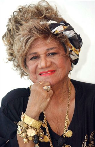 In this undated picture, Puerto Rico&#39;s singer Ruth Fernandez poses for a photo while filming the movie &#34;No Me Digas Adios&#34; in San Juan, Puerto Rico.  Fernandez, a pioneer singer who broke racial and gender barriers and was later elected a senator for the U.S. territory, died Monday Jan. 9, 2012 of septic shock and pneumonia, producer Vicky Hernandez told reporters. She was 92. &#40;AP Photo&#47;El Vocero, Baltazar Vazquez&#41; PUERTO RICO OUT - NO PUBLICAR EN PUERTO RICO <span class=meta>(AP Photo&#47; Baltazar Vazquez)</span>