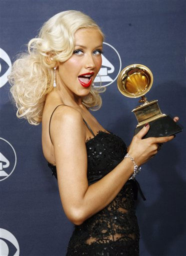 """<div class=""""meta image-caption""""><div class=""""origin-logo origin-image """"><span></span></div><span class=""""caption-text"""">Christina Aguilera poses with the award for best female pop vocal performance for """"Ain't No Other Man"""" at the 49th Annual Grammy Awards on Sunday, Feb. 11, 2007, in Los Angeles. (AP Photo/Kevork Djansezian) (AP Photo/ Kevork Djansezian)</span></div>"""