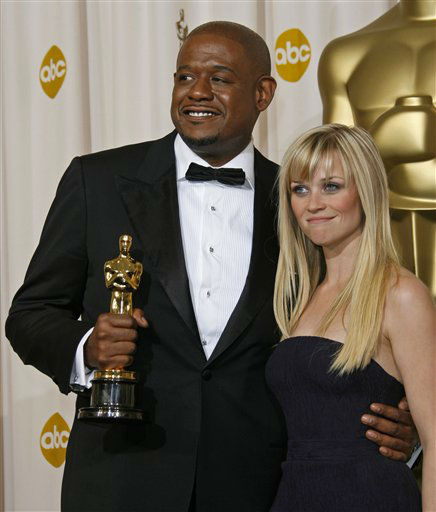 "<div class=""meta ""><span class=""caption-text "">Reese Witherspoon poses with Forest Whitaker after him presenting the award for best actor at the 79th Academy Awards Sunday, Feb. 25, 2007, in Los Angeles. (AP Photo/Kevork Djansezian) (AP Photo/ Kevork Djansezian)</span></div>"
