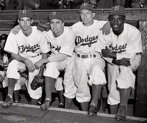 FILE - In this April 15, 1947 file photo,  from left, Brooklyn Dodgers baseball players John Jorgensen, Pee Wee Reese, Ed Stanky and Jackie Robinson pose at Ebbets Field in New York. Kansas City&#39;s Negro Leagues Baseball Museum is hosting an advance screening of an upcoming movie about Robinson, who broke major league baseball&#39;s color barrier. Thomas Butch of the financial firm Waddell and Reed announced Wednesday, March 20, 2013 that actors Harrison Ford and Andre Holland will be among those appearing at an April 11 screening of &#34;42.&#34;   &#40;AP Photo, File&#41; <span class=meta>(AP Photo&#47; Anonymous)</span>