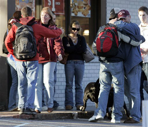 "<div class=""meta ""><span class=""caption-text ""> Virginia Tech freshman, Ryan Fowler, second from right, hugs his dad, Tim, of Mt. Airy, Md., as his mother, MaryEllen  hugs another student near Norris Hall, the site of a shooting on the campus of Virginia Tech  in Blacksburg, Va., Monday, April 16, 2007. Tim and MaryEllen drove down from Maryland to pick up their son after they heard of the shootings. A gunman massacred 32 people at Virginia Tech in the deadliest shooting rampage in modern U.S. history Monday, cutting down his victims in two attacks two hours and a half-mile apart before the university could figure out what was going on and get the warning out to students. (AP Photo/Steve Helber) (AP Photo/ Steve Helber)</span></div>"