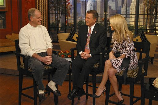 This photo supplied by Buena Vista Television shows ?Late Show? host David Letterman making a rare TV appearance, joining Regis Philbin, center, and Kelly Ripa on ?Live with Regis and Kelly? in New York on Nov, 8, 2004.  Letterman will return to ?Live? on Thursday, April 26, 2007, appearing as the first guest to greet Philbin as veteran host returns to the show after heart bypass surgery six weeks ago.&#40;AP Photo&#47;Buena Vista Televison&#41; <span class=meta>(AP Photo&#47; Anonymous)</span>