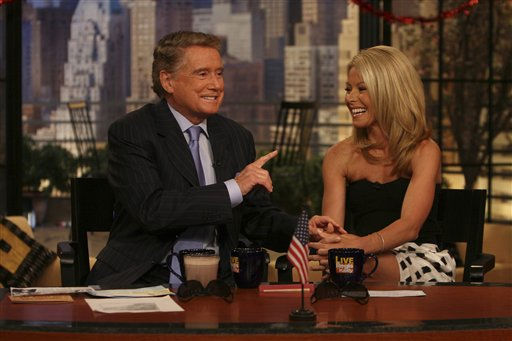 This photo supplied by Buena Vista Television shows host Regis Philbin, on his first day back on the Live with Regis and Kelly  television show, following heart bypass surgery, talking with co-host Kelly Ripa  ,on the show on Thursday, April 26, 2007, in New York. &#40;AP Photo&#47;Buena Vista Television&#41; <span class=meta>(AP Photo&#47; Anonymous)</span>
