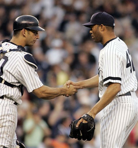 New York Yankees catcher Jorge Posada, left, congratulates Mariano Rivera after the Yankees defeated the  Boston Red Sox, 3-1, in their baseball game, at Yankee Stadium in New York,  Saturday, April 28, 2007. &#40;AP Photo&#47; Ed Betz&#41; <span class=meta>(AP Photo&#47; Ed Betz)</span>