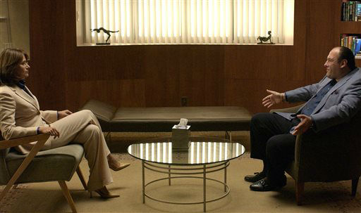 "<div class=""meta ""><span class=""caption-text "">FILE - This undated file photo provided by HBO shows James Gandolfini, as Tony Soprano, right, and Lorraine Bracco, as Dr. Jennifer Melfi, from a scene from the fourth season of ""The Sopranos."" HBO and the managers for Gandolfini say the actor died Wednesday, June 19, 2013, in Italy. He was 51. (AP Photo/HBO, File) (AP Photo/ Uncredited)</span></div>"