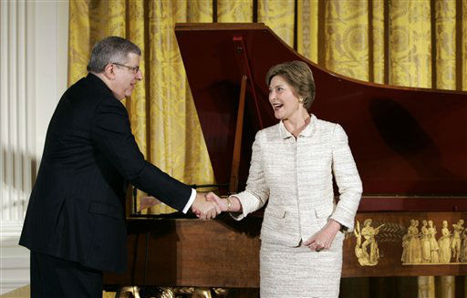 First lady Laura Bush, right, shakes hands with entertainer Marvin Hamlisch after he performed during a luncheon for Senate spouses, Monday, June 18, 2007, at the White House in Washington. &#40;AP Photo&#47;Susan Walsh&#41; <span class=meta>(AP Photo&#47; Susan Walsh)</span>