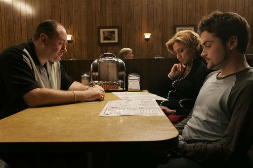 "<div class=""meta image-caption""><div class=""origin-logo origin-image ""><span></span></div><span class=""caption-text"">This undated photo, provided by HBO, shows James Gandolfini, as Tony Soprano, left, Robert Iler, as Anthony Soprano Jr., right, and Edie Falco as Carmela Soprano in the last scene of the HBO series, ""The Sopranos."" Gandolfini, whose portrayal of a brutal, emotionally delicate mob boss in HBO's ""The Sopranos"" helped create one of TV's greatest drama series and turned the mobster stereotype on its head, died Wednesday, June 19, 2013 in Italy. He was 51.(AP Photo/HBO, Will Hart, File) (AP Photo/ WILL HART)</span></div>"