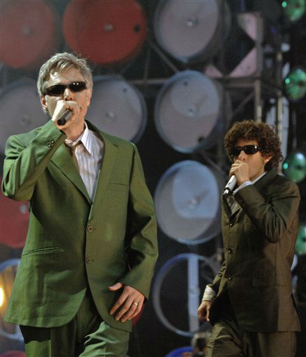 MCA, left, and Mike D of the U.S. band Beastie Boys performs on stage during the British leg of the Live Earth concerts at London&#39;s Wembley Stadium, Saturday July 7, 2007. This concert is part of a series of events, also taking place in the U.S., Australia, China, Japan, Brazil, South Africa and Antarctica. Live Earth was inspired and is backed by by former U.S. Vice President Al Gore&#39;s campaign to force global warming onto the international political agenda by generating public concern. &#40;AP Photo&#47;Anthony Harvey&#41; <span class=meta>(AP Photo&#47; Anthony Harvey)</span>