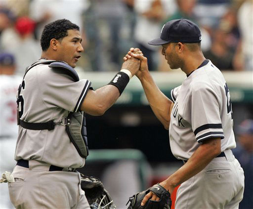 New York Yankees catcher Jose Molina, left, congratulates pitcher Mariano Rivera after the Yankees beat the Cleveland Indians 5-3 in a baseball game Sunday, Aug. 12, 2007, in Cleveland. Starter Andy Pettitte got the win and Rivera the save to sweep the three-game series. &#40;AP Photo&#47;Mark Duncan&#41; <span class=meta>(AP Photo&#47; Mark Duncan)</span>