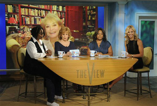 "<div class=""meta image-caption""><div class=""origin-logo origin-image ""><span></span></div><span class=""caption-text"">In this publicity image released by ABC, Barbara Walters is shown on screen as co-hosts, from left, Whoopi Goldberg, Joy Behar, Sherri Shepherd and Elisabeth Hasselbeck are shown during a broadcast of ""The View,"" Monday, July 12, 2010 in New York. Walters made her first TV appearance Monday since the procedure in May to replace a faulty valve. She checked in with her fellow panelists on ABC's ""The View."" (ABC/Jeffrey Neira) (AP Photo/ Jeffrey Neira)</span></div>"