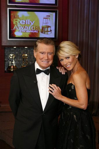 This photo, supplied by Disney ABC, shows &#34;Live with Regis and Kelly&#34; co-hosts Regis Philbin and Kelly Ripa hosting the fifth annual Relly Awards on Friday, Sept. 21, 2007 on the &#34;Live&#34; show in New York.  The awards pay tribute to the best on-air moments of the past year on ?Live,? with the nominees decided by the viewers all year long and ?Live?s? Relly academy.  The winners are determined by the at-home viewing audience, who cast their votes online.  The winner in each category takes home a Golden Stool trophy. The 76-year-old talk-show host was overlooked yet again for the &#34;Best Regis&#34; award. &#40;AP Photo&#47;Disney-ABC&#41; <span class=meta>(AP Photo&#47; Anonymous)</span>