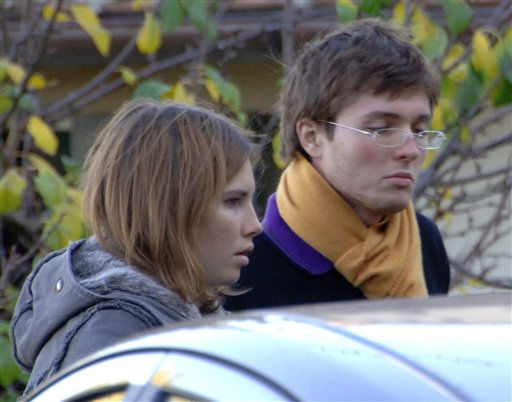 ** FILE ** Photo taken Friday Nov. 2, 2007, and made available on Tuesday Nov. 6, 2007 shows Amanda Marie Knox, left, with her then boy friend Raffaele Sollecito of Italy, looking on outside the rented house where 21-year-old British student Meredith Kercher was found dead in Perugia, Italy. &#40;AP Photo&#47;Stefano Medici, file&#41; <span class=meta>(AP Photo&#47; STEFANO MEDICI)</span>