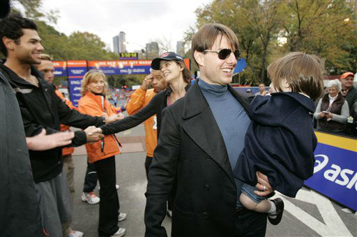 Spectators congratulate actress Katie Holmes as her husband, actor Tom Cruise holds their daughter Suri after Holmes finished the New York City Marathon in New York, Sunday, Nov. 4, 2007. &#40;AP Photo&#47;Kathy Willens&#41; <span class=meta>(AP Photo&#47; Kathy Willens)</span>