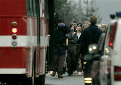 Pupils are evacuated from the Jokela high school in Tuusula, Finland, Wednesday, Nov. 7, 2007 where a teenager opened fire at a school in southern Finland on Wednesday, shooting four people - one of them fatally - before being surrounded by police, media reports and a municipal official said. Police confirmed the shooting at Jokela high school in Tuusula, some 50 kilometers &#40;30 miles&#41; north of the capital, Helsinki, but said they could not give details. &#40;AP Photo&#47;Mikko Stig&#47;Lehtikuva&#41;  ** FINLAND OUT NO SALES   ** <span class=meta>(AP Photo&#47; Mikko Stig)</span>