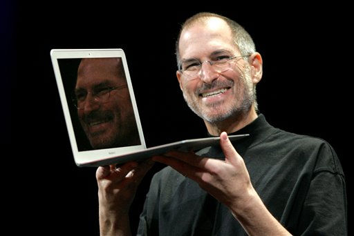 "<div class=""meta ""><span class=""caption-text "">Apple CEO Steve Jobs holds up the new MacBook Air while giving the keynote address at Apple MacWorld Conference in San Francisco, Tuesday, Jan. 15, 2008. The super-slim new laptop is less than an inch thick and turns on the moment it's opened. (AP Photo/Jeff Chiu) (AP Photo/ Jeff Chiu)</span></div>"