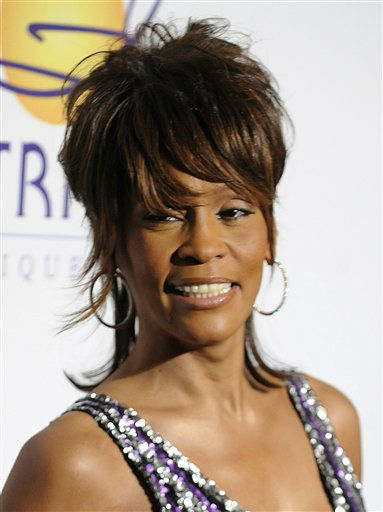 FILE  - In this Feb. 9, 2008 file photo, singer Whitney Houston arrives at the Clive Davis Pre-Grammy Party in Beverly Hills, Calif. Whitney Houston, who reigned as pop music&#39;s queen until her majestic voice and regal image were ravaged by drug use, has died, Saturday, Feb. 11, 2012. She was 48. &#40;AP Photo&#47;Chris Pizzello, file&#41; <span class=meta>(AP Photo&#47; Chris Pizzello)</span>