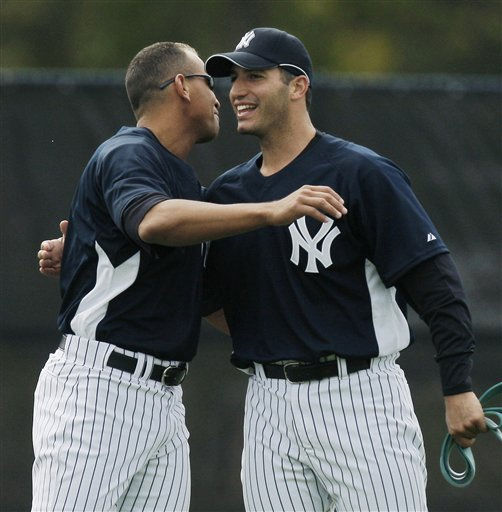 New York Yankees third baseman Alex Rodriguez, left, hugs pitcher Andy Pettitte while stretching in the outfield during spring training baseball workouts Wednesday, Feb. 20, 2008 in Tampa, Fla. Wednesday was the first day of workouts for position players. &#40;AP Photo&#47;Julie Jacobson&#41; <span class=meta>(AP Photo&#47; Julie Jacobson)</span>