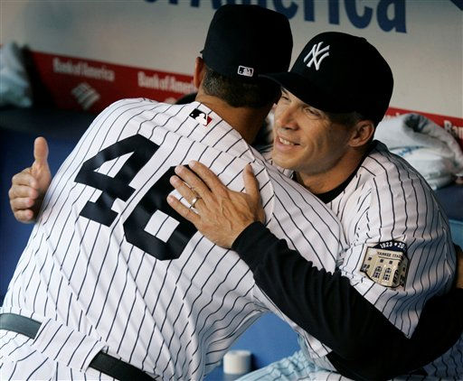 New York Yankees&#39; Andy Pettitte embraces manager Joe Girardi in the dugout before Yankees&#39; baseball game against the Toronto Blue Jays at Yankee Stadium in New York, Tuesday, April 1, 2008. The Yankees won 3-2. &#40;AP Photo&#47;Kathy Willens&#41; <span class=meta>(AP Photo&#47; Kathy Willens)</span>