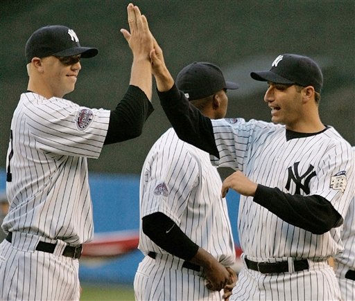 New York Yankees&#39; Shelley Duncan, left, greets pitcher Andy Pettitte after Pettitte was introduced before the Yankees&#39; baseball home opener against the Toronto Blue Jays at Yankee Stadium in New York, Tuesday, April 1, 2008. Pettitte received a mostly warm welcome when he was introduced at the New York Yankees&#39; opener after a tumultuous offseason. &#40;AP Photo&#47;Kathy Willens&#41; <span class=meta>(AP Photo&#47; Kathy Willens)</span>