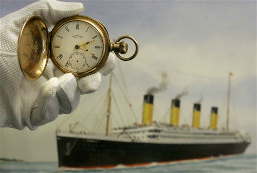 A gold plated Waltham American pocket watch, the property of Carl Asplund, is seen in front of a modern water colour painting of the Titanic by CJ Ashford at Henry Aldridge and Son auctioneers  in Devizes, Wiltshire, England Thursday, April 3, 2008. The watch, expected to reach 15,000- 20,000 pounds, euro19, 000-25,000, US&#36;30,000- 39,000 was recovered from the body of Carl Asplund who drowned on the Titanic and is part of the Lillian Asplund collection, the last American survivor of the disaster, which go on auction on April 19. Asplund was 5 in April 1912, when the Titanic hit an iceberg and sank on its maiden voyage from England to New York. Her father and three siblings were among 1,500 people who died. &#40;AP Photo&#47;Kirsty Wigglesworth&#41; <span class=meta>(AP Photo&#47; Kirsty Wigglesworth)</span>