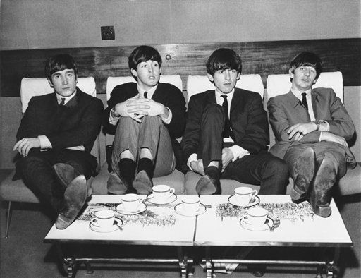 The Beatles, Britain&#39;s top rock band, relax in London over tea in 1963.    The group from left:  John Lennon, Paul McCartney; George Harrison and Ringo Starr.  The group is sporting similar thatch haircuts with bangs to the edge of their eyebrows.    No other information available with photo.  &#40;AP Photo&#41; <span class=meta>(AP Photo&#47; PEC)</span>