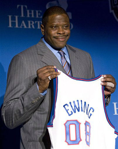In this file photo taken April 7, 2008, Naismith Memorial Basketball Hall of Fame inductee Patrick Ewing holds up a jersey during a news conference in San Antonio. On Tuesday, March 6, 2012, Ewing of Georgetown and the NBA New York Knicks, was announced as part of the 10-member class that will be inducted into the National Collegiate Basketball Hall of Fame in November. &#40;AP Photo&#47;Mark Humphrey, file&#41; <span class=meta>(AP Photo&#47; Mark Humphrey)</span>