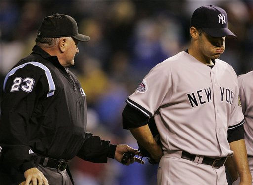Umpire crew chief Rick Reed &#40;23&#41; walks off the field with New York Yankees starting pitcher Andy Pettitte during the fourth inning a major league baseball game with the Kansas City Royals in Kansas City, Mo., Thursday, April 10, 2008. The game was halted because of bad weather. &#40;AP Photo&#47;Orlin Wagner&#41; <span class=meta>(AP Photo&#47; Orlin Wagner)</span>