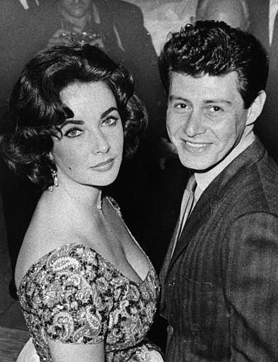 Actress Elizabeth Taylor is seen with singer Eddie Fisher before their marriage in 1959. &#40;AP Photo&#41; <span class=meta>(AP Photo&#47; XMB)</span>