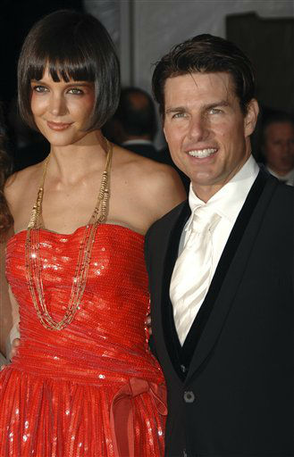 "<div class=""meta image-caption""><div class=""origin-logo origin-image ""><span></span></div><span class=""caption-text"">Tom Cruise and his wife Katie Holmes arrive at the Metropolitan Museum of Art's Costume Institute Gala, in New York on Monday, May 5, 2008. (AP Photo/Peter Kramer) (AP Photo/ Peter Kramer)</span></div>"
