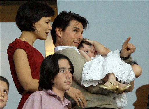 Actor Tom Cruise, holding their child, Suri, and wife Katie Holmes watch the Los Angeles Galaxy&#39;s and New York Red Bulls&#39;  MLS soccer match from David Beckham&#39;s box in Carson, Calif., Saturday, May 10, 2008. &#40;AP Photo&#47;Chris Carlson&#41; <span class=meta>(AP Photo&#47; Chris Carlson)</span>