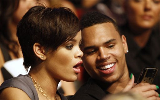 "<div class=""meta image-caption""><div class=""origin-logo origin-image ""><span></span></div><span class=""caption-text"">Rihanna, left, and Chris Brown are seen at the MTV Movie Awards on Sunday June 1, 2008 in Los Angeles. (AP Photo/Matt Sayles) (AP Photo/ Matt Sayles)</span></div>"