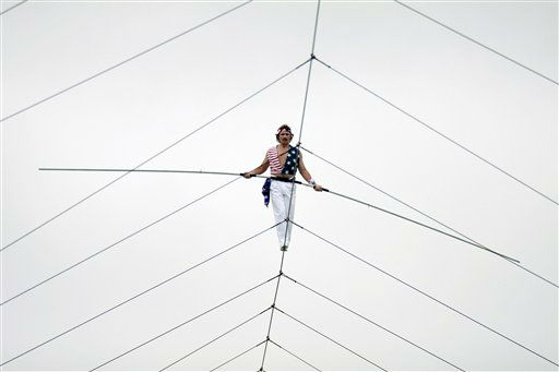 "<div class=""meta ""><span class=""caption-text "">In this photo provided by King's Island, Rick Wallenda walks along a tight rope at King's Island in southwestern Ohio at an Independence Day show, Friday, July 4, 2008. Thousands of people spending Independence Day at Kings Island watched in silence as daredevil Rick Wallenda walked 2,000 feet across a cable suspended high above the Cincinnati-area amusement park. The 35-minute feat surpassed the 1,800-foot sky-walk made at Kings Island in 1974 by his grandfather Karl Wallenda, patriarch of ""The Flying Wallendas"". (AP Photo/King's Island,  Bruce Crippen) ** NO SALES  ** (AP Photo/ Bruce Crippen)</span></div>"